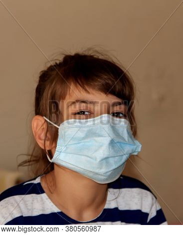 A Child In A Mask On Inpatient Treatment In A Hospital.