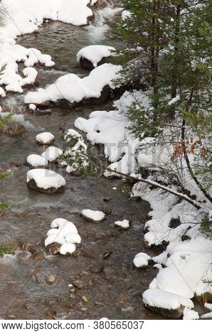 Sia River with its snow-covered banks. Pyrenees. Huesca. Aragon. Spain.