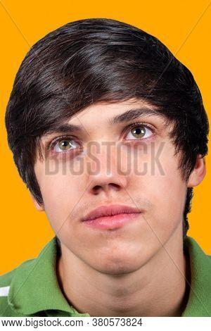 Caucasian teenager headshot portrait on colorful background