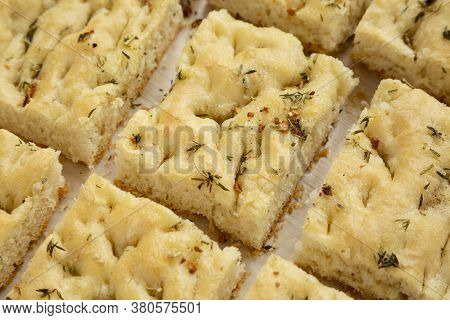 Home-baked Rosemary Garlic Focaccia Bread, Close-up. Healthy