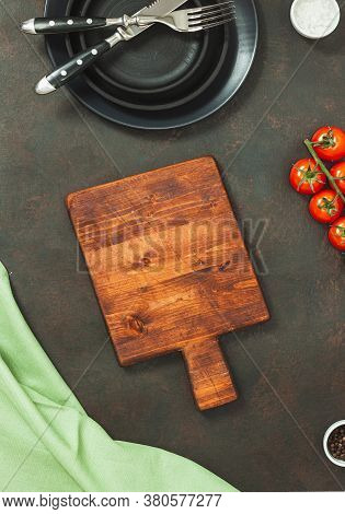 Chopping Board, Seasonings And Rosemary On Dark Wooden Background. Cutting Board For Menu. Food Cook