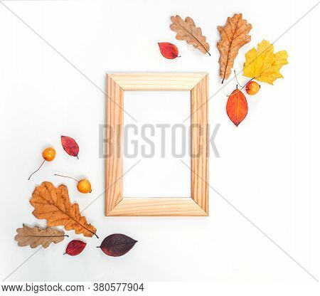 Autumn Composition. Fall Frame Made Of Autumn Leaves, Acorn, Pine Cones On White Background. Flat La