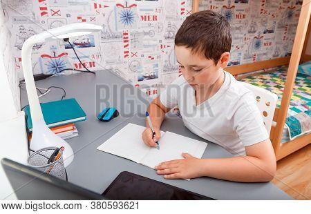 Schoolboy Using Desktop Computer For Online Study Homeschooling During Home Quarantine. Home Schooli