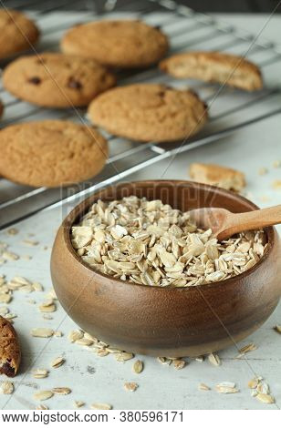 Oatmeal Close-up In A Wooden Bowl And Oatmeal Cookies