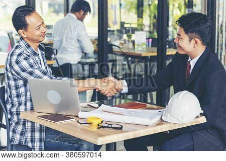 Diversity Two Business Partners Shaking Hands Together With Business Contract Mergers And Acquisitio