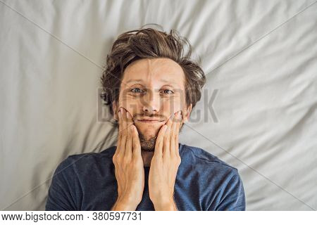 Extremly Tired Young Man Lying On The Bed, Home Alone. Self-isolation At Home, Quarantine Due To Pan