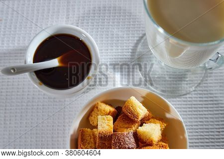 Square Toasted Pieces Of Homemade Delicious Rusk, Hardtack, Dryasdust, Zwieback, Liquid Honey In A P