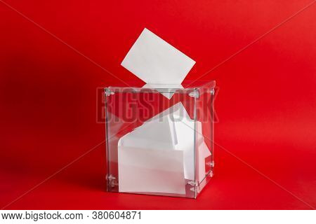 Voting Box With Bulletins On Red Background, Space For Text