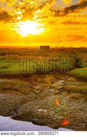 sunset on fishing hut- France landscape
