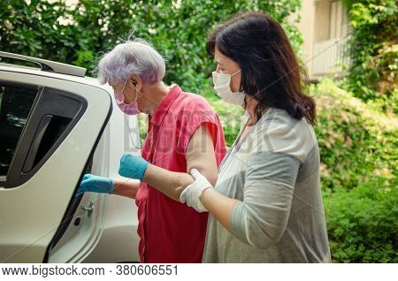 Caregiver Traveling Back And Forth From The Hospital And An Elderly Client Home To Attend A Series O
