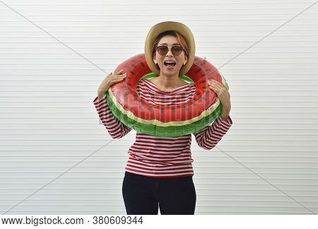 Happy Young Asian Woman Wearing Red Stripped Shirt, Sunglasses, Straw Hat And Jeans In Watermelon In