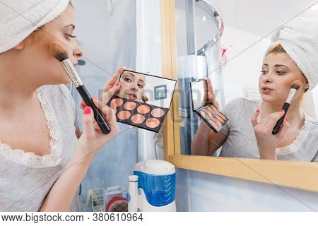 Contouring Face Kit, Visage And Make Up Concept. Woman In Bathroom Applying Contour Bronzer On Cheek