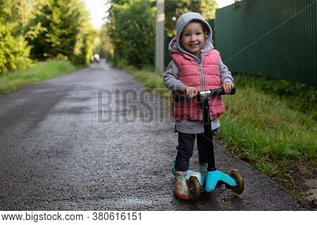 Pretty Toddler Girl With Scooter In The Coutryside