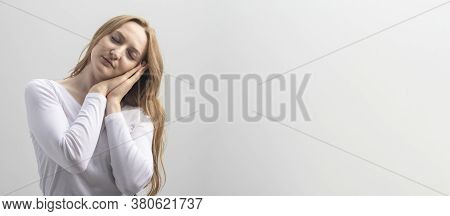 Girl With Closed Eyes Expressing Boredom And Pretending Asleep. Young Caucasian Woman In White Blous