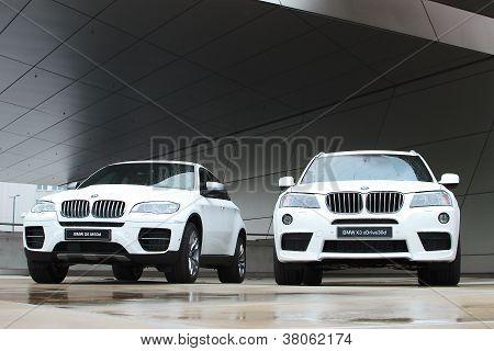 Two white BMW X-series