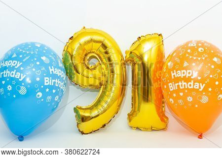 Inflatable Numeral 91 Sparkling Metallic Golden Color With Blue And Yellow Balloons Isolated On Whit