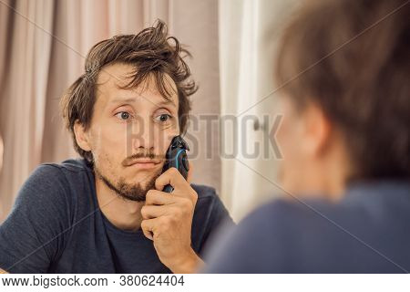 Extremly Tired Young Man Looking At Himself In The Mirror, Home Alone. Self-isolation At Home, Quara