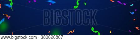 Streamers And Confetti. Festive Streamers Tinsel And Foil Ribbons. Confetti Frame On Dark Blue Backg