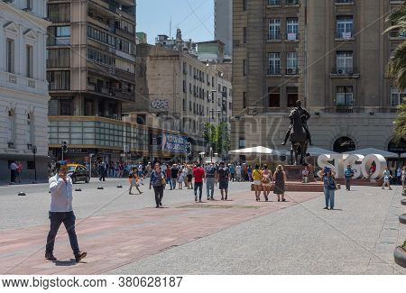 Unidentified People Walk On Plaza De Armas Square In The Center Of Santiago, Chile