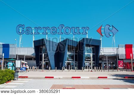 EL PRAT DE LLOBREGAT, SPAIN - AUGUST 7, 2020: A view of the main facade of the Carrefour hypermarket, a popular hypermarket chain in Spain, and one of the most important hypermarket chains in Europe