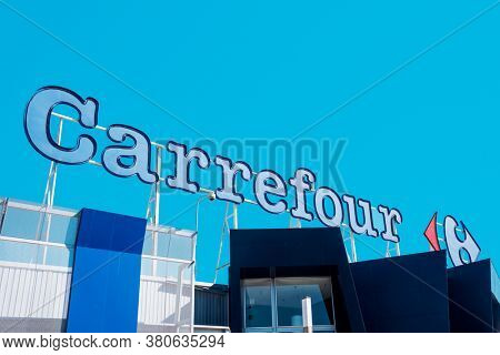 EL PRAT DE LLOBREGAT, SPAIN - AUGUST 7, 2020: Detail of the logo of the Carrefour hypermarket, a popular hypermarket chain in Spain, and one of the most important hypermarket chains in Europe