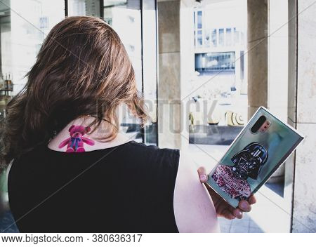 Moscow, Russia, July 2020: A View From The Back Of A Girl With Wind In Her Hair And A Pink Teddy Bea
