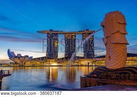 SINGAPORE CITY SINGAPORE: JULY 16 2020: Singapore Merlion Park downtown Singapore  business district at sunrise