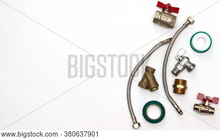 Plumbing Tools Flat Lay Background With Copy Space. Work Tools And Pipeline Parts On Plumber Workben