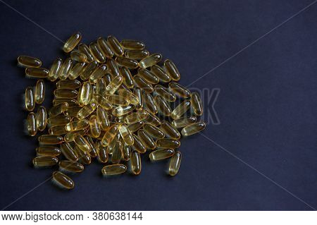 Heap Of Fish Oil Omega 3/60 Healthy Food Supplements Close Up Taken On The Black Background With Cop