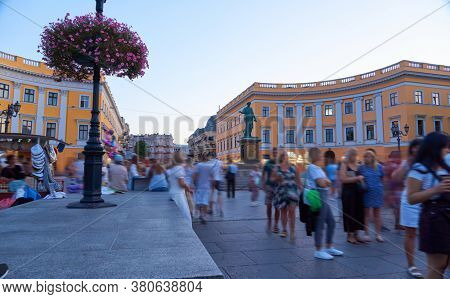 people and tourists in the center of Odessa at the Monument to Duc de Richelieu