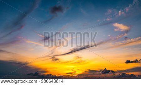 Beautiful Sunset Sky Over The Sea. Blue Sky And Bright Sunrise Sunset Over The Horizon.