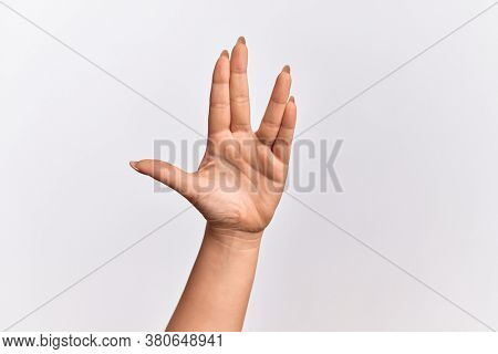 Hand of caucasian young woman greeting doing Vulcan salute, showing hand palm and fingers, freak culture