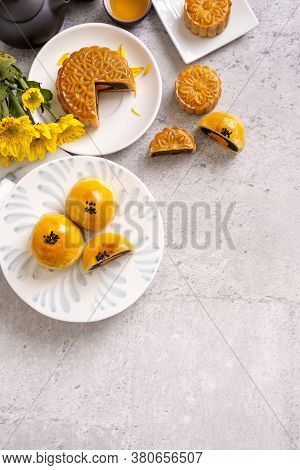 Tasty Baked Egg Yolk Pastry Moon Cake For Mid-autumn Festival On Bright Cement Table Background. Chi