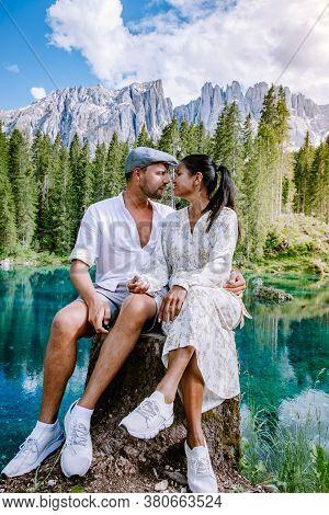 Couple Visit Hte Bleu Lake In The Dolomites Italy, Carezza Lake Lago Di Carezza, Karersee With Mount