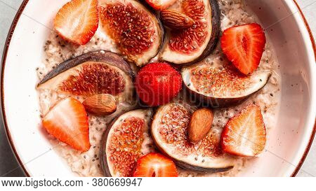 Healthy Diet Breakfast. Overnight Oatmeal With Chia Seeds And Fruits Figs, Strawberries, Food Recipe