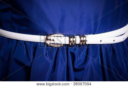 Elegant white belt in the blue dres