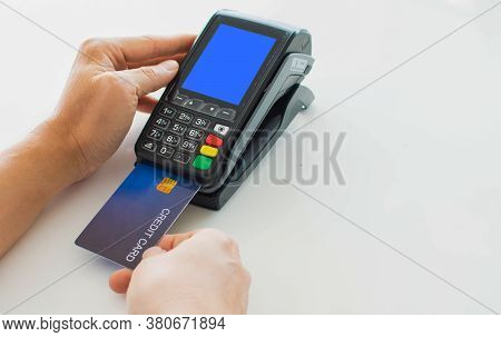 Paying With A Credit Card For A Man's Hand, Put A Credit Card Into A Card Reader To Pay Instead Of C