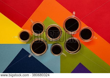 Few Thermo Glass Cups With Fresh Black Espresso And Americano Coffee. Colorful Abstract Background I