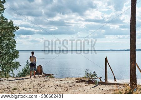 Young Man Is Looking At The Beautiful Sea With Clouds Near Forest Trailway, Weekend Activities In Su