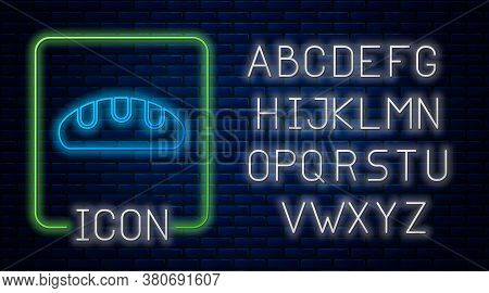 Glowing Neon Bread Loaf Icon Isolated On Brick Wall Background. Neon Light Alphabet. Vector