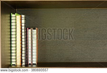 Old And Well Used Hardback Books Or Text Books On A Shelf  Or Library. Many Books Piles. Hardback Bo