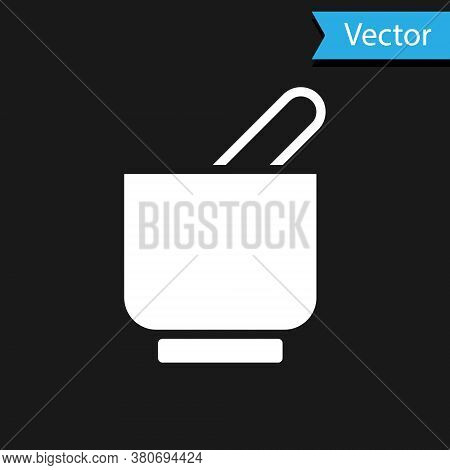 White Mortar And Pestle Icon Isolated On Black Background. Vector