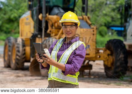 Engineer Women Use Tablet For Working At Construction Site.real Estate Building Project With Constru