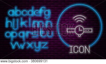 Glowing Neon Line Smartwatch Icon Isolated On Brick Wall Background. Internet Of Things Concept With