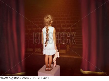 Little Girl Dreaming A Dancing Ballet On The Stage. Childhood Concept.
