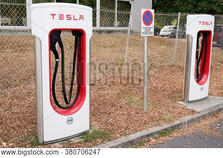Bordeaux , Aquitaine / France - 07 30 2020 : Tesla Supercharger White Red Station Charging Of Vehicl