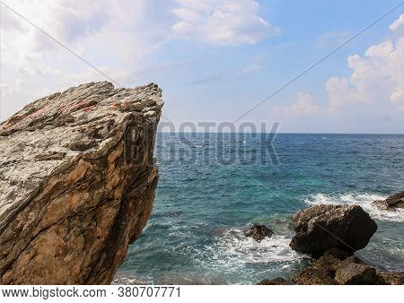 Big Rocks In The Middle Of The Sea Or Ocean With Great Blue Raging Water Waves Breaking On A Stone.