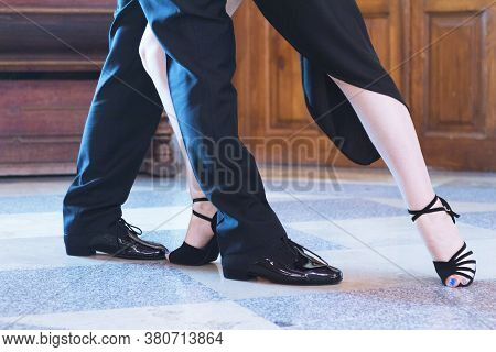 Legs Of Man And Woman Dancing Argentine Tango. Black Shoes