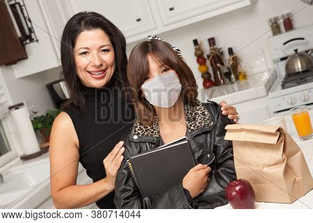 Young Hispanic Girl Student with Mother At Home Getting Ready For School Wearing Medical Face Mask.