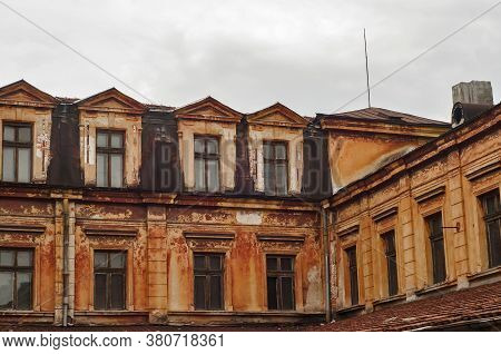Old Vintage Dacayed Neglected Building Facade Closeup In Cloudy Day
